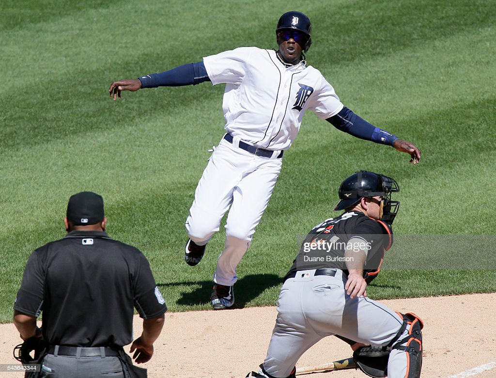 <a gi-track='captionPersonalityLinkClicked' href=/galleries/search?phrase=Cameron+Maybin&family=editorial&specificpeople=2364846 ng-click='$event.stopPropagation()'>Cameron Maybin</a> #4 of the Detroit Tigers scores on catcher <a gi-track='captionPersonalityLinkClicked' href=/galleries/search?phrase=Jeff+Mathis&family=editorial&specificpeople=660661 ng-click='$event.stopPropagation()'>Jeff Mathis</a> #6 of the Miami Marlins on a single by Miguel Cabrera as home plate umpire Adrian Johnson covers the play during the eighth inning at Comerica Park on June 29, 2016 in Detroit, Michigan. The Tigers defeated the Marlins 10-3.