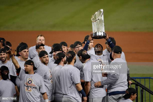 Cameron Maybin of the Houston Astros holds the Commissioner's Trophy after defeating the Los Angeles Dodgers 51 in game seven to win the 2017 World...