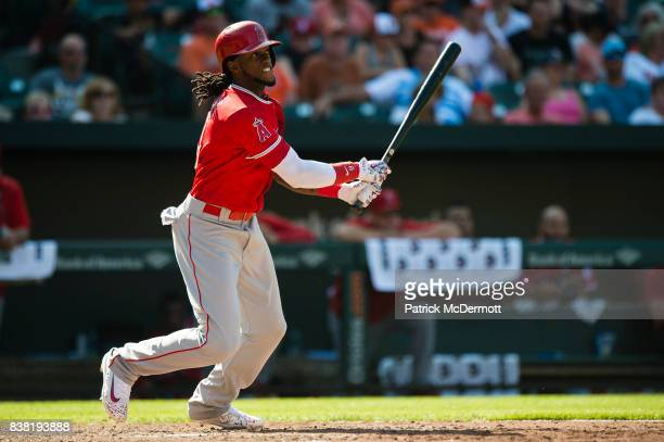 Cameron Maybin of the Los Angeles Angels of Anaheim hits a RBI single in the eighth inning scoring Kole Calhoun during a game against the Baltimore...