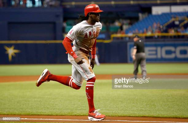 Cameron Maybin of the Los Angeles Angels sprints home to score on a sacrifice fly by Andrelton Simmons during the first inning of a game against the...