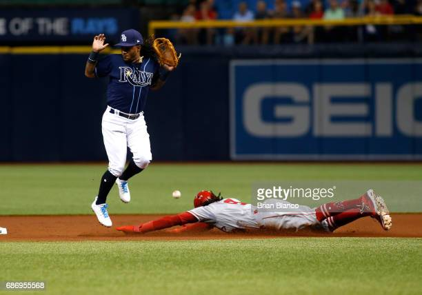Cameron Maybin of the Los Angeles Angels steals second base against second baseman Michael Martinez of the Tampa Bay Rays before advancing to third...