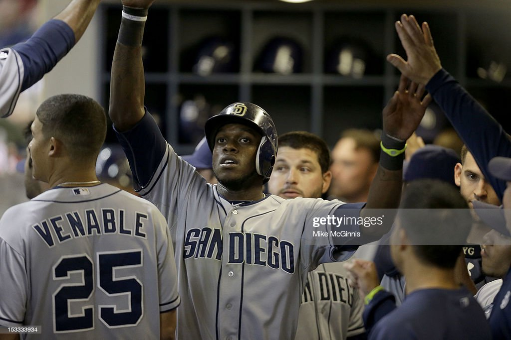 <a gi-track='captionPersonalityLinkClicked' href=/galleries/search?phrase=Cameron+Maybin&family=editorial&specificpeople=2364846 ng-click='$event.stopPropagation()'>Cameron Maybin</a> #24 of the San Diego Padres celebrates in the dugout after hitting a two-run home run in the top of the sixth inning against the Milwaukee Brewers at Miller Park on October 3, 2012 in Milwaukee, Wisconsin.