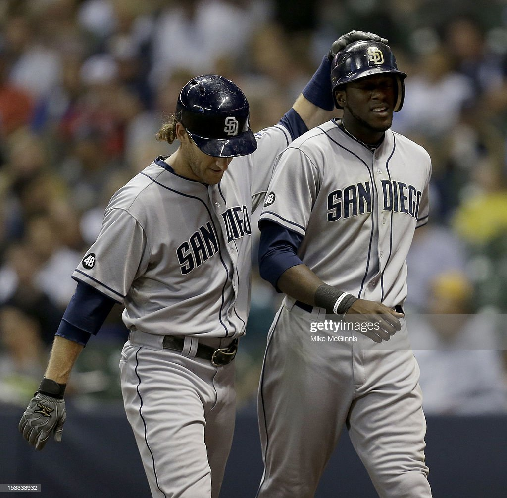 <a gi-track='captionPersonalityLinkClicked' href=/galleries/search?phrase=Cameron+Maybin&family=editorial&specificpeople=2364846 ng-click='$event.stopPropagation()'>Cameron Maybin</a> #24 of the San Diego Padres celebrates with <a gi-track='captionPersonalityLinkClicked' href=/galleries/search?phrase=Chris+Denorfia&family=editorial&specificpeople=702417 ng-click='$event.stopPropagation()'>Chris Denorfia</a> #13 after hitting a two-run home run in the top of the sixth inning against the Milwaukee Brewers at Miller Park on October 3, 2012 in Milwaukee, Wisconsin.