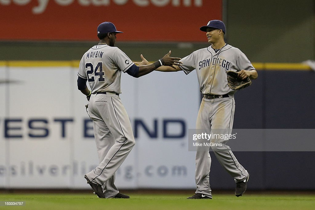 <a gi-track='captionPersonalityLinkClicked' href=/galleries/search?phrase=Cameron+Maybin&family=editorial&specificpeople=2364846 ng-click='$event.stopPropagation()'>Cameron Maybin</a> #24 of the San Diego Padres celebrates with <a gi-track='captionPersonalityLinkClicked' href=/galleries/search?phrase=Will+Venable&family=editorial&specificpeople=3068470 ng-click='$event.stopPropagation()'>Will Venable</a> #25 after the 7-6 win over the Milwaukee Brewers at Miller Park on October 3, 2012 in Milwaukee, Wisconsin.