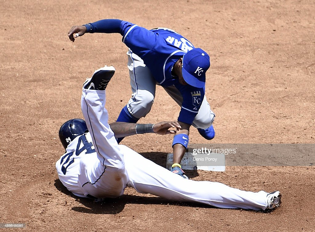 Cameron Maybin #24 of the San Diego Padres is tagged out by Alcides Escobar #2 of the Kansas City Royals as he caught off second base during the second inning of a baseball game at Petco Park May 7, 2014 in San Diego, California.