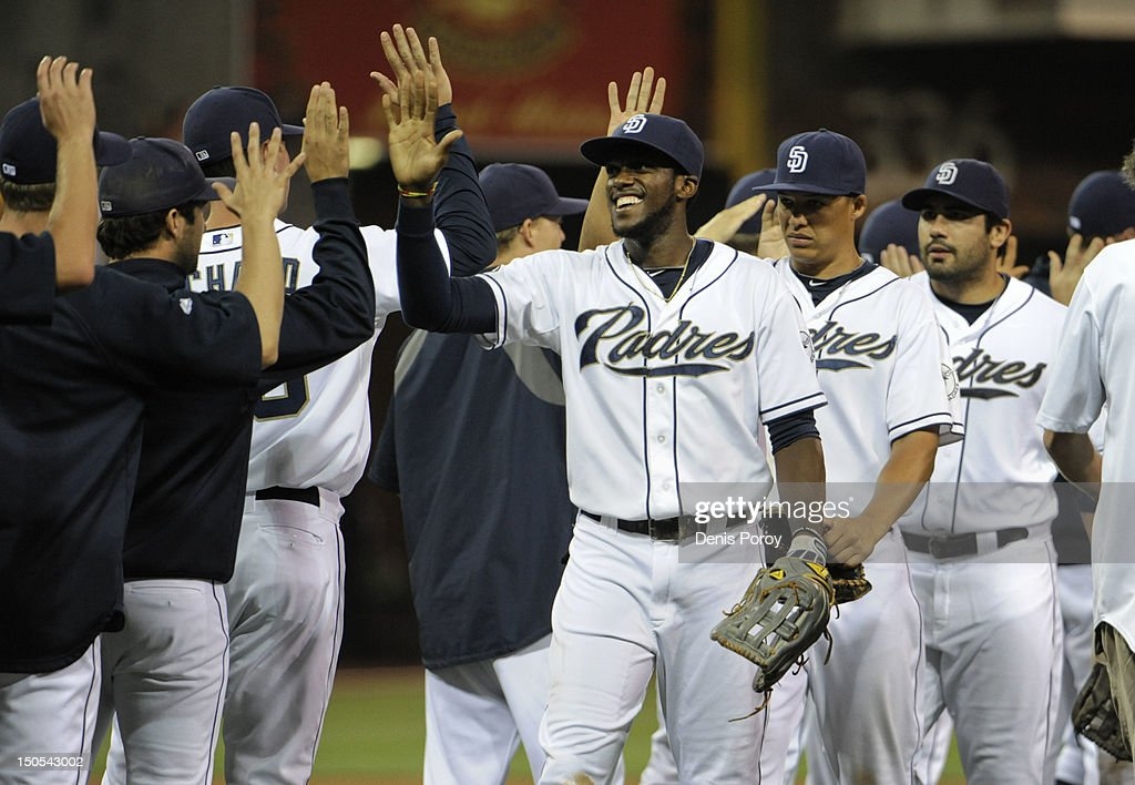 <a gi-track='captionPersonalityLinkClicked' href=/galleries/search?phrase=Cameron+Maybin&family=editorial&specificpeople=2364846 ng-click='$event.stopPropagation()'>Cameron Maybin</a> #24 of the San Diego Padres (C) smiles as he high-fives teammates after beating the Pittsburgh Pirates 3-1 in a baseball game at Petco Park on August 20, 2012 in San Diego, California.