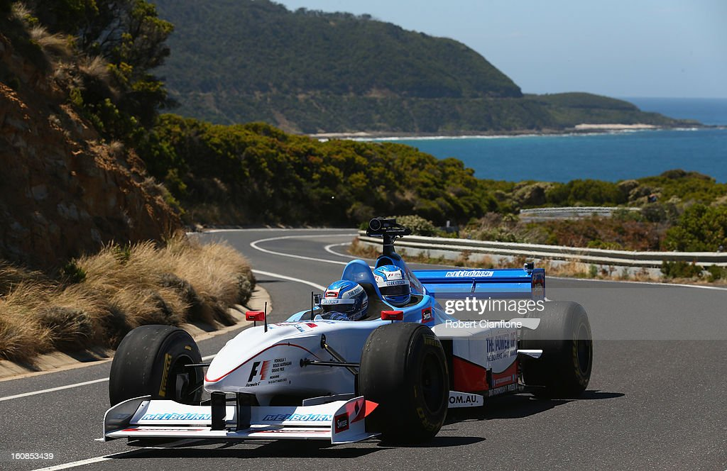 Cameron McConville drives the two seater formula one car during the filming of a Television advertisment on the Great Ocean Road on February 7, 2013 in Kennett River, Australia.