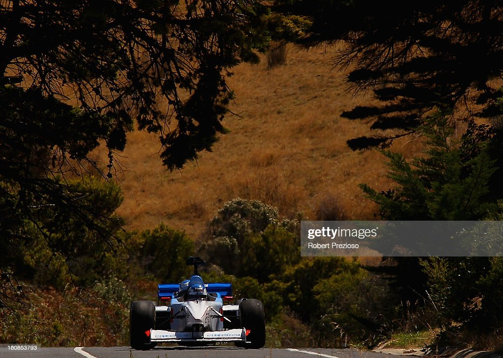 <a gi-track='captionPersonalityLinkClicked' href=/galleries/search?phrase=Cameron+McConville&family=editorial&specificpeople=224884 ng-click='$event.stopPropagation()'>Cameron McConville</a> drives the two seater formula one car during the filming of a Television advertisment on the Great Ocean Road on February 7, 2013 in Kennett River, Australia.