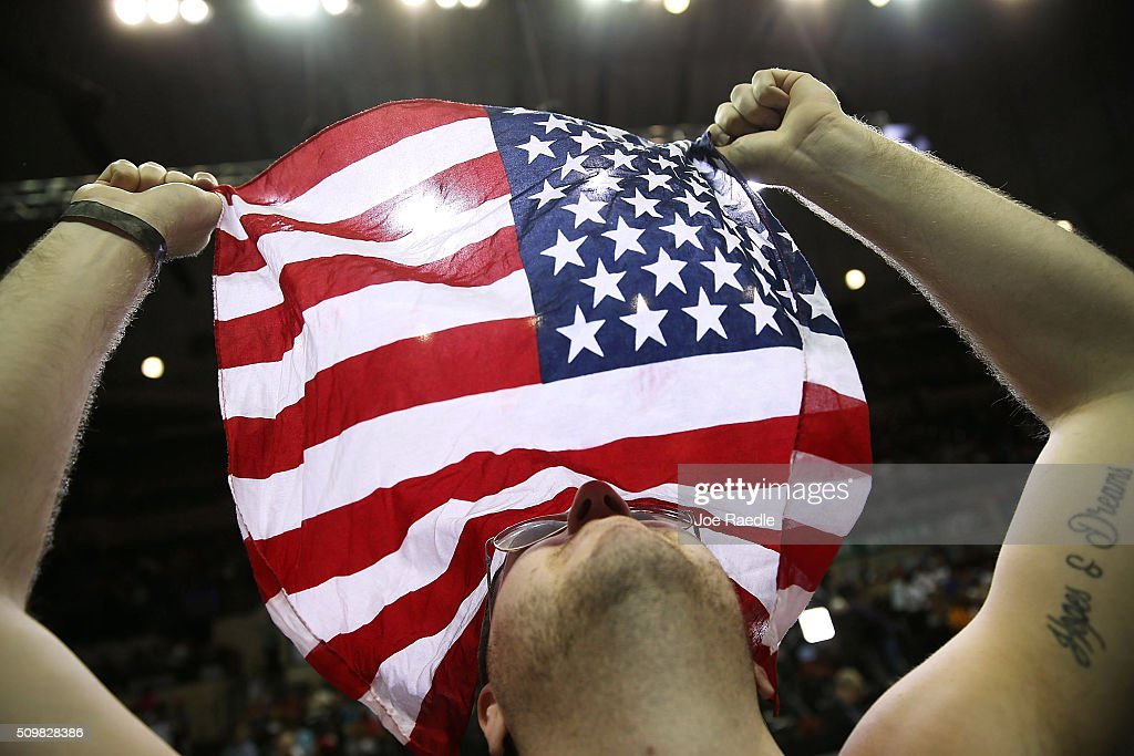 Cameron McDaniel holds an American flag as he waits for the start of a campaign rally for Republican presidential candidate Donald Trump at the University of South Florida Sun Dome on February 12, 2016 in Tampa, Florida. The process to select the next Democratic and Republican Presidential candidate continues.