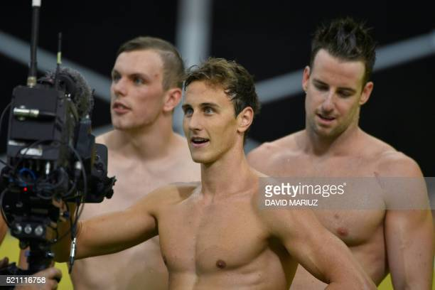 Cameron McEvoy and team mates Kyle Chalmers and James Magnussen react after the men's 4x100m freestyle relay final on the final day of the 2016...