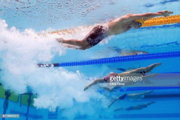 Cameron Mcevoy of Australia and Katsumi Nakamura of Japan competes during the Men's 100m Freestyle Heats on day thirteen of the Budapest 2017 FINA...