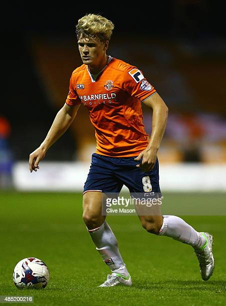 Cameron McGeehan of Luton Town in action during the Capital One Cup second round match between Luton Town and Stoke City at Kenilworth Road on August...