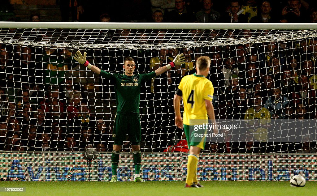 Cameron McGeehan of Norwich City prepares to take his penalty kick against Mitchell Beeney of Chelsea during the FA Youth Cup Final First Leg match between Norwich City and Chelsea at Carrow Road on April 29, 2013 in Norwich, England.