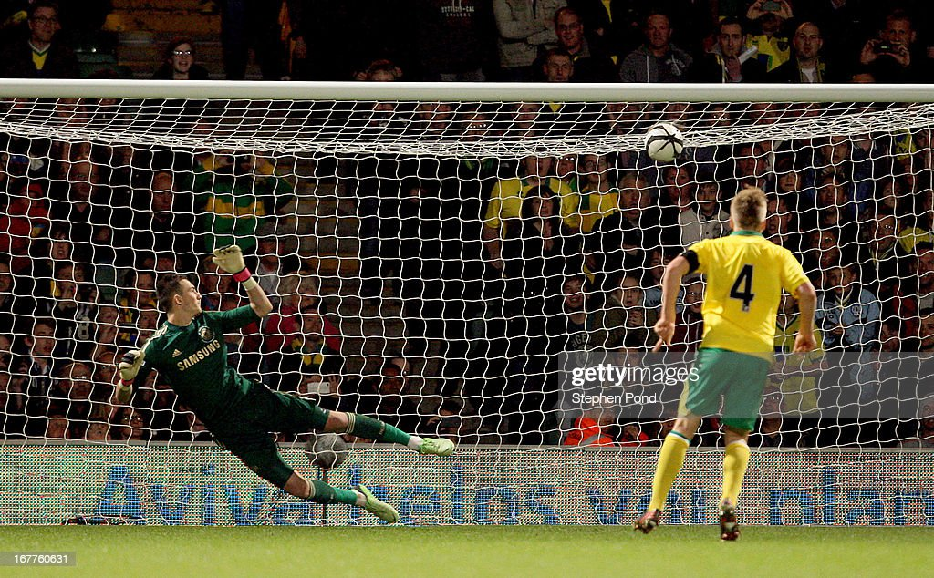 Cameron McGeehan of Norwich City scores from the penalty spot past Mitchell Beeney of Chelsea during the FA Youth Cup Final First Leg match between Norwich City and Chelsea at Carrow Road on April 29, 2013 in Norwich, England.