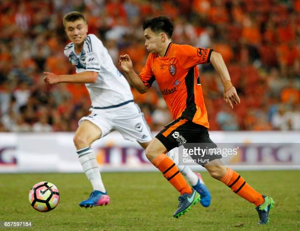 R Cameron McGilp of the Victory and Joe Caletti of the Roar chase the ball during the round 24 ALeague match between Brisbane Roar and Melbourne...