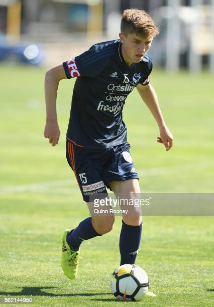 Cameron McGlip of the Victory passes the ball during a Melbourne Victory ALeague training session at Gosch's Paddock on October 17 2017 in Melbourne...