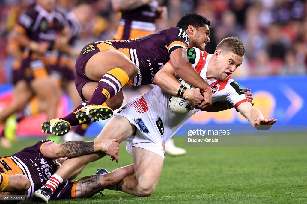 Cameron McInnes of the Dragons is tackled during the round 24 NRL match between the Brisbane Broncos and the St George Illawarra Dragons at Suncorp Stadium on August 18, 2017 in Brisbane, Australia.