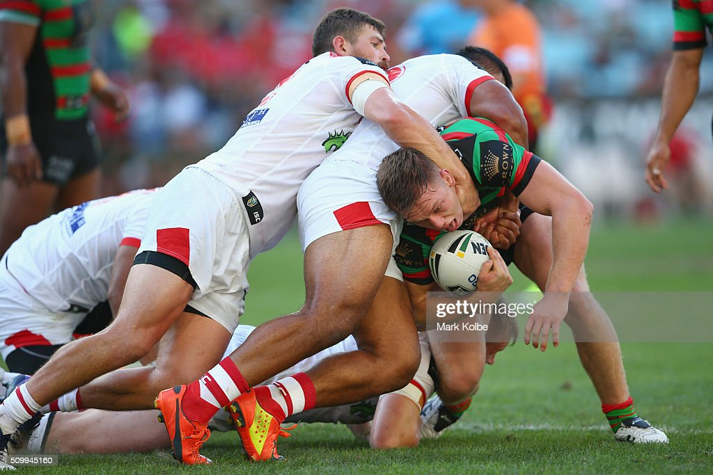 Cameron McInnes of the Rabbitohs is tackled during the NRL Charity Shield match between the St George Illawarra Dragons and the South Sydney Rabbitohs at ANZ Stadium on February 13, 2016 in Sydney, Australia.