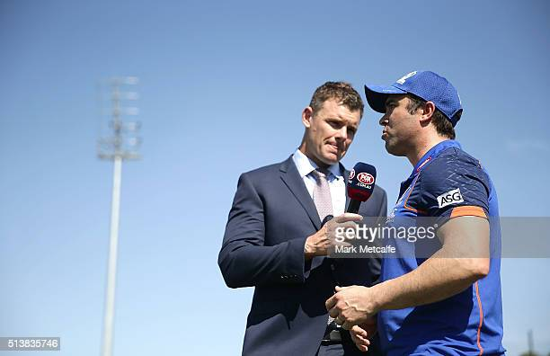 Cameron Mooney interviews Kangaroos head coach Brad Scott before the 2016 AFL NAB Challenge match between the North Melbourne Kangaroos and the...