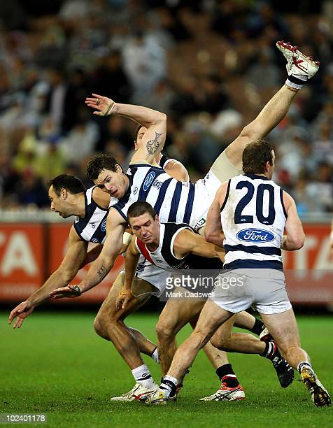 Cameron Mooney of the Cats crashes down onto the pack after flying for a mark during the round 13 AFL match between the St Kilda Saints and the...