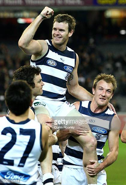 Cameron Mooney of the Cats is carried off the ground by teammates after playing his 200th game during the round nine AFL match between the...