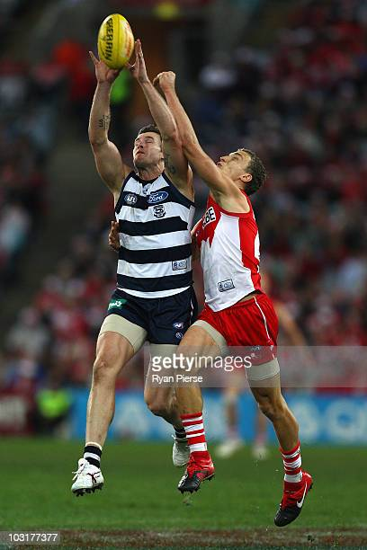Cameron Mooney of the Cats marks in front of Ted Richards of the Swans during the round 18 AFL match between the Sydney Swans and the Geelong Cats at...