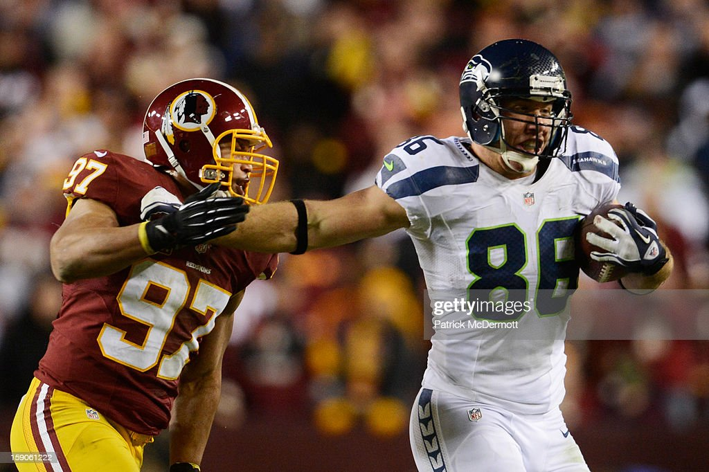 Cameron Morrah #88 of the Seattle Seahawks tries to avoid the tackle of <a gi-track='captionPersonalityLinkClicked' href=/galleries/search?phrase=Lorenzo+Alexander&family=editorial&specificpeople=772505 ng-click='$event.stopPropagation()'>Lorenzo Alexander</a> #97 of the Washington Redskins during the NFC Wild Card Playoff Game at FedExField on January 6, 2013 in Landover, Maryland.