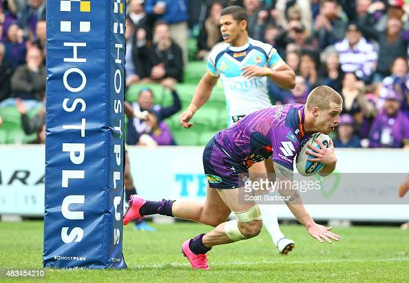 Cameron Munster of the Melbourne Storm scores a try during the round 22 NRL match between the Melbourne Storm and the Gold Coast Titans at AAMI Park...