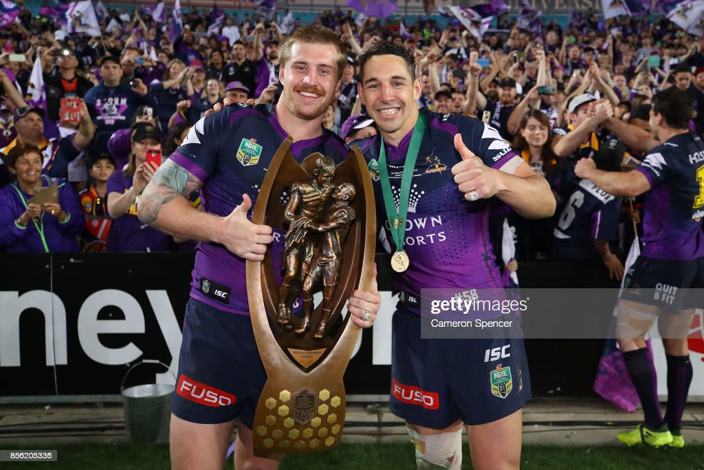 Cameron Munster of the Storm and Billy Slater of the Storm pose with the Provan-Summons Trophy after winning the 2017 NRL Grand Final match between the Melbourne Storm and the North Queensland Cowboys at ANZ Stadium on October 1, 2017 in Sydney, Australia.