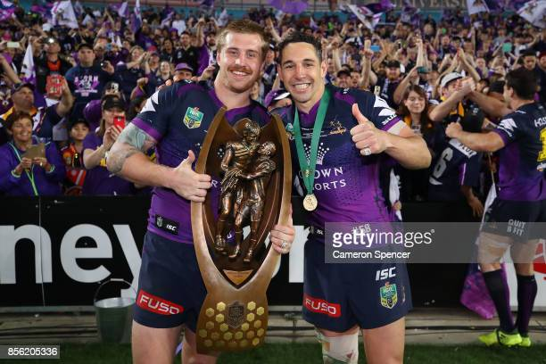 Cameron Munster of the Storm and Billy Slater of the Storm pose with the ProvanSummons Trophy after winning the 2017 NRL Grand Final match between...