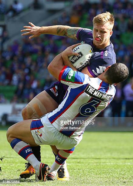 Cameron Munster of the Storm is tackled by Jarrod Mullen of the Knights during the round five NRL match between the Melbourne Storm and the Newcastle...