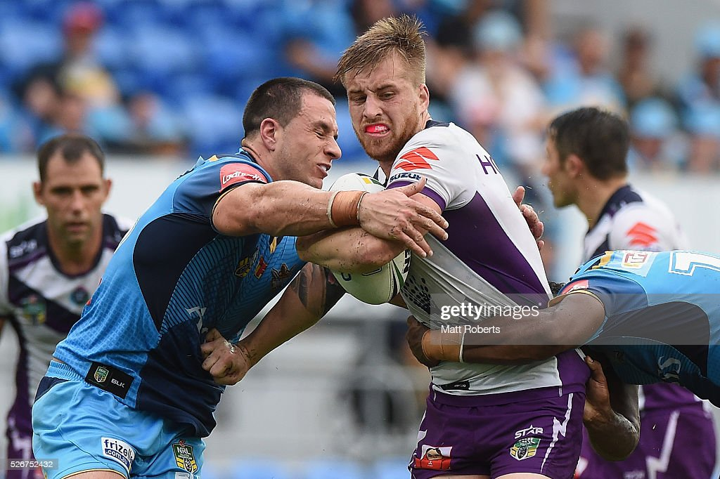 Cameron Munster of the Storm is tackled during the round nine NRL match between the Gold Coast Titans and the Melbourne Storm on May 1, 2016 in Gold Coast, Australia.