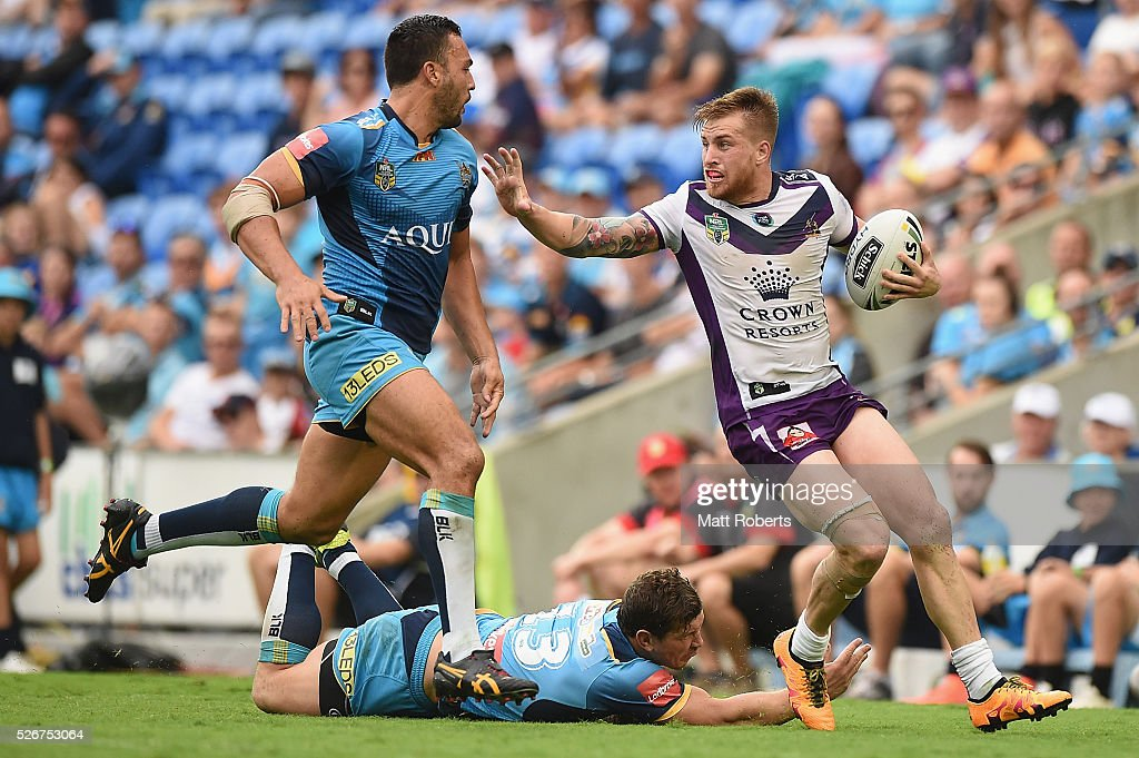 Cameron Munster of the Storm runs with the ball during the round nine NRL match between the Gold Coast Titans and the Melbourne Storm on May 1, 2016 in Gold Coast, Australia.