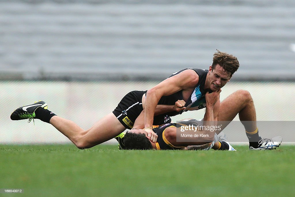 Cameron O'Shea of the Power holds down his opponent during the round seven AFL match between Port Adelaide Power and the Richmond Tigers at AAMI Stadium on May 11, 2013 in Adelaide, Australia.