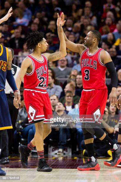 Cameron Payne of the Chicago Bulls and Dwyane Wade celebrate after a play during the first half against the Cleveland Cavaliers at Quicken Loans...