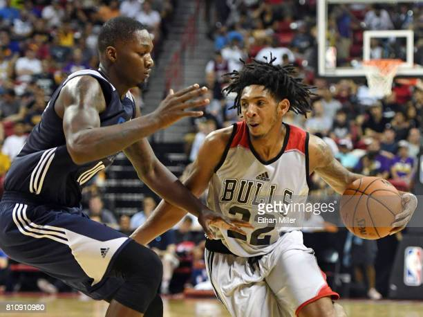 Cameron Payne of the Chicago Bulls drives against Dorian FinneySmith of the Dallas Mavericks during the 2017 Summer League at the Thomas Mack Center...