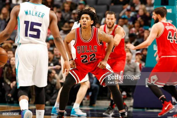 Cameron Payne of the Chicago Bulls plays defense against the Charlotte Hornets on March 13 2017 at Spectrum Center in Charlotte North Carolina NOTE...