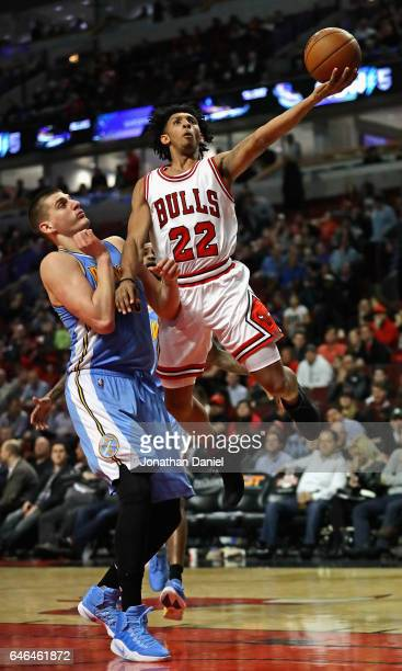 Cameron Payne of the Chicago Bulls puts up a shot over Nikola Jokic of the Denver Nuggets at the United Center on February 28 2017 in Chicago...