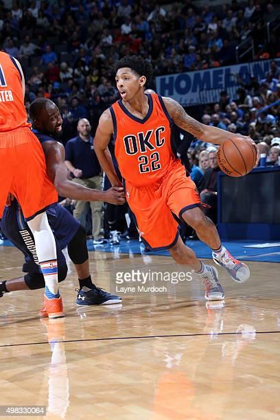 Cameron Payne of the Oklahoma City Thunder drives to the basket against the Dallas Mavericks on November 22 2015 at Chesapeake Energy Arena in...