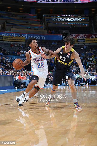 Cameron Payne of the Oklahoma City Thunder handles the ball against Berk Ugurlu of Fenerbahce during a preseason game on October 9 2015 at Chesapeake...