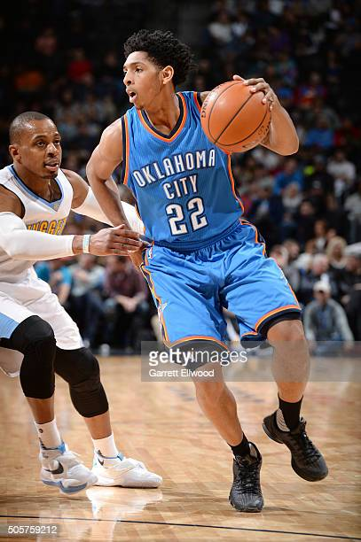 Cameron Payne of the Oklahoma City Thunder handles the ball during the game against the Denver Nuggets on January 19 2016 at the Pepsi Center in...