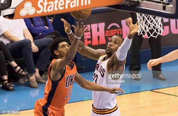 Cameron Payne of the Oklahoma City Thunder puts up a shot against LeBron James of the Cleveland Cavaliers for two points during the fourth quarter of...
