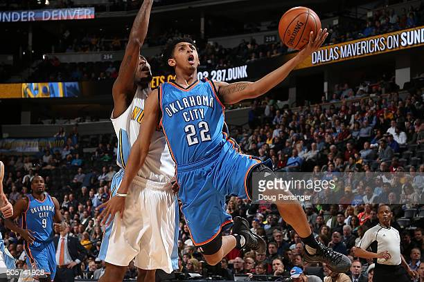 Cameron Payne of the Oklahoma City Thunder puts up a shot only to have it blocked by Will Barton of the Denver Nuggets at Pepsi Center on January 19...