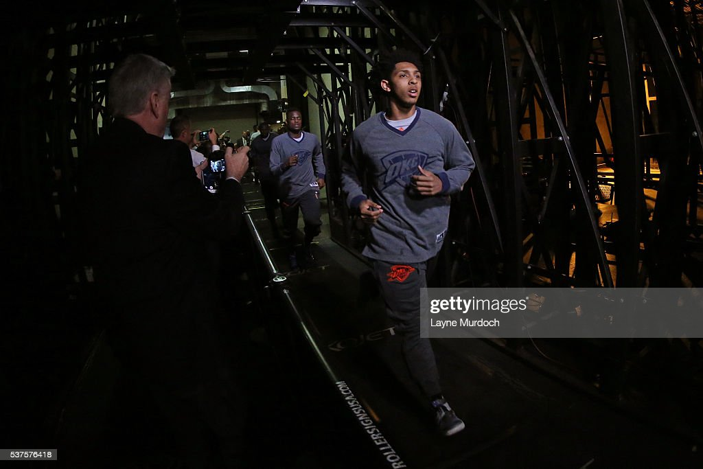 Cameron Payne #22 of the Oklahoma City Thunder runs out of the tunnel before Game Five of the Western Conference Finals against the Golden State Warriors during the 2016 NBA Playoffs on May 26, 2016 at ORACLE Arena in Oakland, California.