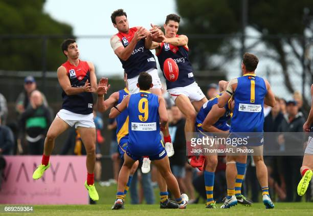 Cameron Pedersen and Jordan Moncrieff of the Casey Demons attempt to mark the ball during the round one VFL match between Williamstown and Casey...
