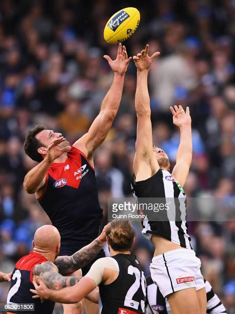 Cameron Pedersen of the Demons and Darcy Moore of the Magpies compete in the ruck during the round 12 AFL match between the Melbourne Demons and the...