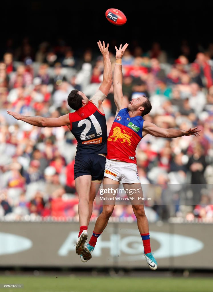 Cameron Pedersen of the Demons and Josh Walker of the Lions during the 2017 AFL round 22 match between the Melbourne Demons and the Brisbane Lions at the Melbourne Cricket Ground on August 20, 2017 in Melbourne, Australia.