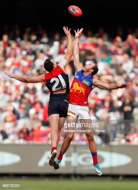 Cameron Pedersen of the Demons and Josh Walker of the Lions during the 2017 AFL round 22 match between the Melbourne Demons and the Brisbane Lions at...