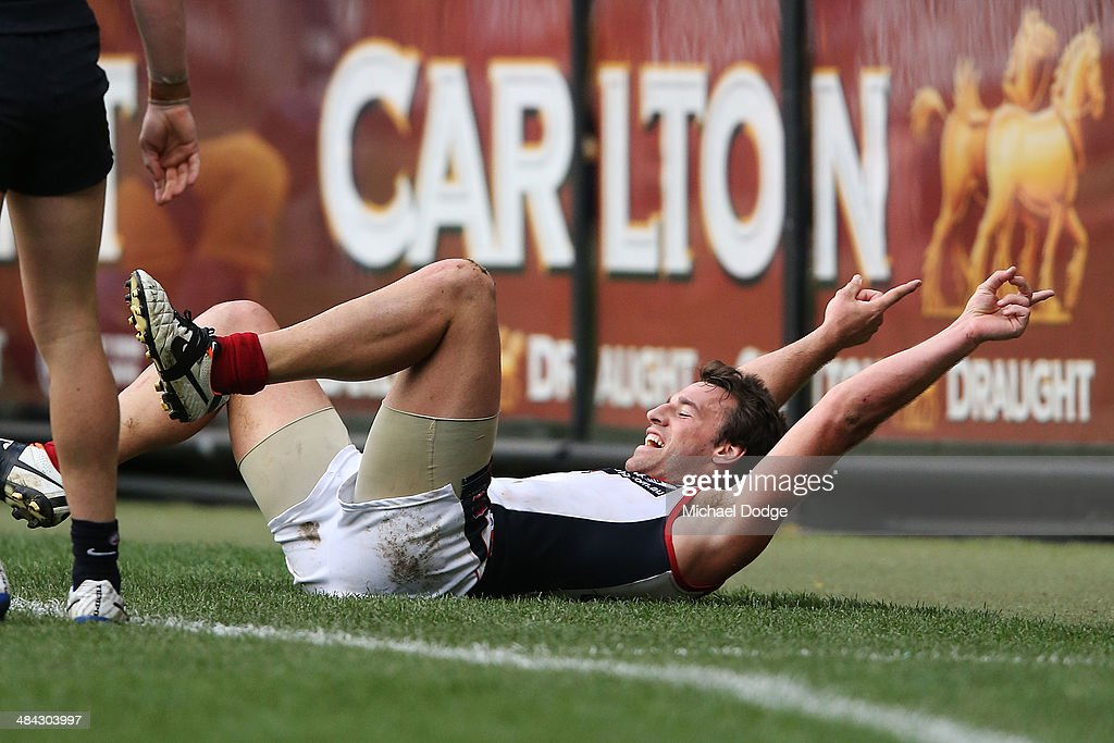 Cameron Pedersen of the Demons celebrates a goal during the round four AFL match between the Carlton Blues and the Melbourne Demons at Melbourne Cricket Ground on April 12, 2014 in Melbourne, Australia.