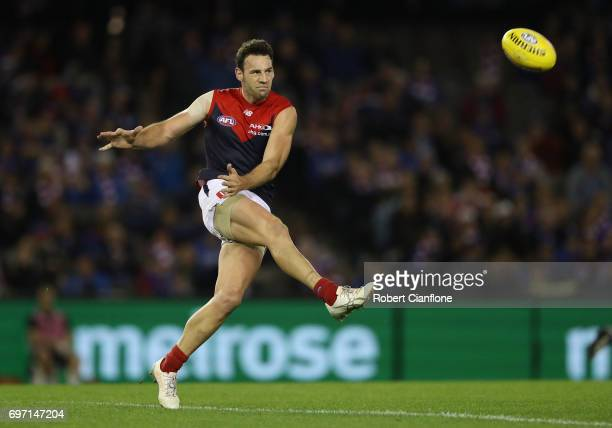 Cameron Pedersen of the Demons kicks the ball during the round 13 AFL match between the Western Bulldogs and the Melbourne Demons at Etihad Stadium...